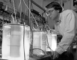"Charles Bennett examines three ""cold fusion"" test cells at the Oak Ridge National Laboratory, USA"