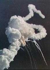 Main engine exhaust, solid rocket booster plume and an expanding ball of gas from the external tank is visible seconds after the explosion.