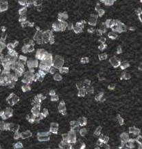 Magnified view of refined sugar crystals.