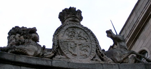 Royal Coat of Arms after the Act of Union 1800 Displayed over the   in Dublin. These arms of dominion are similar to the royal arms before the union inasmuch as the arms of Ireland (the harp) form one quarter of the shield with the remaining quarters referring to the kings other realms (ie: England, Scotland and Hanover).