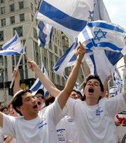 Kippot Sruggot:   students carry the  at a public parade in , NY, USA