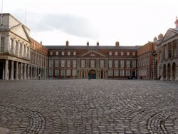 Dublin Castle. The Upper Courtyard. On the left is the state entrance and the Viceregal Apartments. The Irish Crown Jewels were stolen from the building to the right.