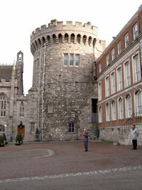 One of the surviving mediæval towers. To its left is the .
