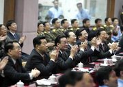 , 3rd left, , 4th left, , 2nd left, , 5th left, , 1st left, and , 6th left, react to the launch of Shenzhou V.