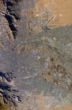 El Paso (top) and Ciudad Ju�rez (bottom) as seen from earth orbit; the Rio Grande River is the thin line separating the two cities through the middle of the photograph. A portion of the Franklin Mountains can be seen in the upper-left. Image courtesy of NASA.