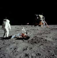 Aldrin stands next to the Passive Seismic Experiment Package with the  in the background.