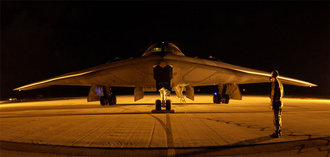 A B-2 Spirit parked at night