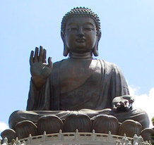 Statues of Buddha such as this, the  statue in , remind followers to practice right living.