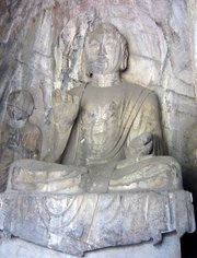 A  Dynasty sculpture of  Buddha, found in the Hidden Stream Temple Cave, ,  indicates.