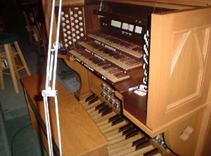 The organ console at , , .  The stop knobs on this console are placed to the left and right of the keyboards.