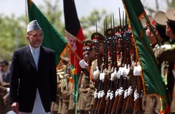 President Karzai reviews the first soldiers of the Afghan National Army.