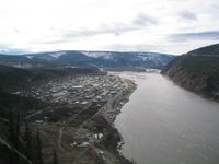 Aerial view of Dawson City with the Yukon river in early May