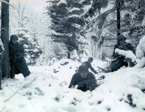 American soldiers taking up defensive positions in the Ardennes during the Battle of the Bulge