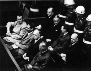 Defendants in the dock - Front row: G�ring, Hess, von Ribbentrop, and Keitel. Second row: D�nitz, Raeder, Schirach, Sauckel.