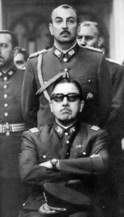 Pinochet (sitting) as head of the military junta.