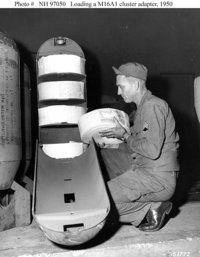 "Soldier loads a ""leaflet bomb"" during the ."