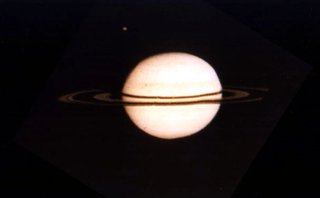 One of the first spacecraft views of  was taken by Pioneer 11 on , , three days before its closest encounter. The   is visible to the upper left.
