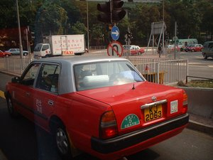 An urban red taxi in Hong Kong.