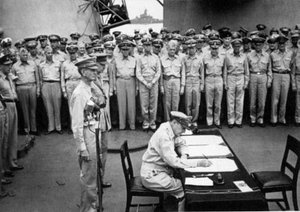 Japanese and American delegates, in the company of Allied commanders, watch the surrender ceremony unfold aboard Missouri on . The unconditional surrender of the Japanese to the  officially ended the .