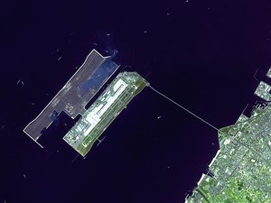 Satellite closeup of the airport and its bridge. Construction of the second runway-island is underway. Rinku Town is visible on the mainland.