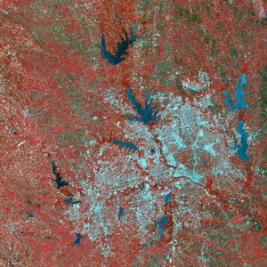 A simulated-color satellite image of Dallas and , Texas, taken by NASA's Landsat 7 satellite. Dallas makes up much of the right half of the urbanized area. Red is vegetated area surrounding DFW.  Notice also the many reservoirs in the area.