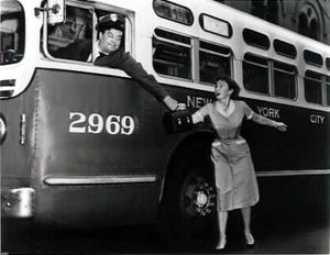 Jackie Gleason and  in a staged publicity shot for .  While Gleason's Ralph Kramden was a bus driver, he was never seen actually driving a bus in the series.