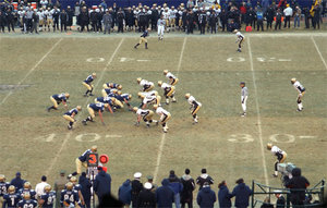 Football players line up before the play during the 2002 annual .  , on the left, has possession.