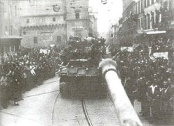 Polish Tanks greeted by cheering crowds, enter .