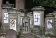 A French Jewish cemetery after being crudely defaced by Neo-Nazis