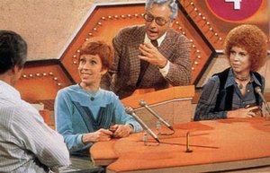 Allen Ludden, as emcee of Password, presiding over a round with celebrity guests  (left) and  (right).
