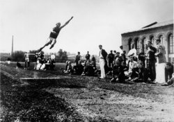 Owens setting the world record in the long jump at the  in 1935