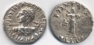 "Silver  of Menander I (160-135 BC). Obv:  legend, BASILEOS SOTHROS MENANDROY lit. ""Saviour King Menander"".  Rev:  legend: MAHARAJA TRATASA MENADRASA ""Saviour King Menander"".  advancing right, with thunderbolt and shield."