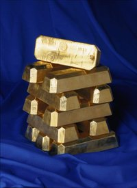 Gold ingots like these, from the , form the base of many monetary systems.