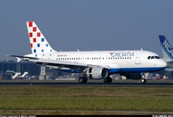 Croatia Airlines Airbus A319-100 near a Nippon Cargo Airways 747, at Amsterdam (Schiphol) Airport, the Netherlands.