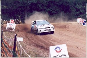 A Subaru Impreza WRX competing in a rally.