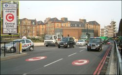 At Old Street street markings and a sign (inset) with the white-on-red C alert drivers to the charge.