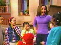 Gabby, Elmo, and some kids sing the Kitten-Bird-Cow song, in front of 123 Sesame Street.