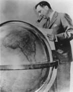 Juan Trippe surveying his office globe.