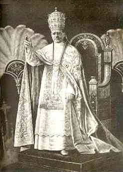 Pope Pius XI (1922-1939) wearing a papal tiara.