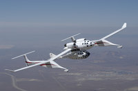 All SpaceShipOne flights begin with the  carrying SpaceShipOne to altitude, about 14 km, as demonstrated in this  test of the two-vehicle system.  The two vehicles have identical cockpits, as can be seen from the pattern of windows.