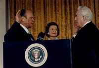 Vice President Ford is sworn in as the 38th President of the United States by Chief Justice  as  looks on.