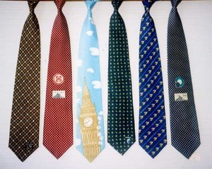 Modern neckties, shown here tied as if they were on a person, may be found in a plethora of colours and designs.