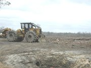 Modern Log  on clearcut plot, . This photo demonstrates extreme soil disturbance typical of poor forestry practices.