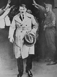 Hitler walking out of Brown House after 1930 elections