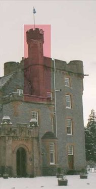 Turret (highlighted) attached to a tower on a baronial building in Scotland