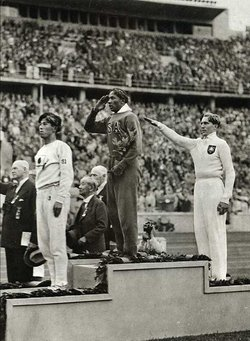 Medal ceremony for the long jump at the 1936 Olympics with Tajima, Owens and Lutz Long.
