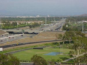 A typical suburban freeway ( in ) with an  in the foreground